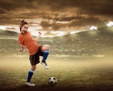Happy woman soccer player Kuvituskuvat