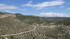 Spain Sierra de Gudar landscape with road around hill Stock Footage