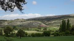 Spain Sierra de Gudar wheat field and hills Stock Footage