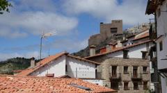 Spain Alcala de la Selva castle beyond roofs Stock Footage