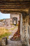 View on old stone passage way in ussr fortress - stock photo