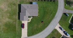 Aerial Zoom In View Man Mowing Lawn  	 - stock footage