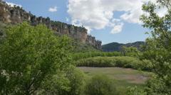 Spain Serrania de Cuenca cliffs beyond Una lagoon Stock Footage