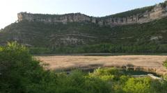 Spain Serrania de Cuenca cliffs over Una lagoon reeds Stock Footage