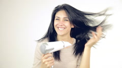 Happy woman playing with long hair blow drying isolated Stock Footage