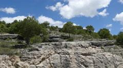 Spain Serrania de Cuenca cloud over trees on cliff Stock Footage