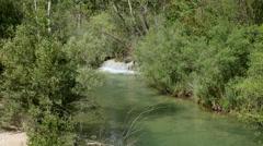 Spain Serrania de Cuenca Rio Jucar with small waterfall Stock Footage