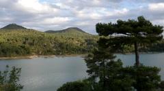 Spain Serrania de Cuenca tree with mountain lake Stock Footage