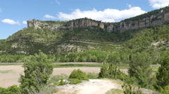 Spain Serrania de Cuenca viewing reeds below cliffs Stock Footage