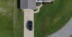 Aerial View Homeowner Returning Home SUV into Garage - stock footage