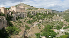 Spain Cuenca buildings on cliff and below city Stock Footage