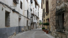 Spain Cuenca street past inn Stock Footage
