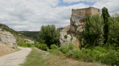 Spain Alto Tajo castle on rock with road and poppies Stock Footage