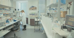 Scientist working in a pharmaceutical laboratory Stock Footage