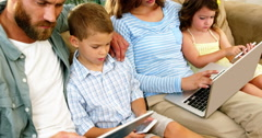 Geeky family using technologies Stock Footage