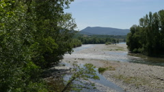 Spain Pyrenees river flowing past gravel bars Stock Footage