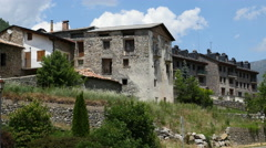 Spain Pyrenees El Run stone houses old and new Stock Footage
