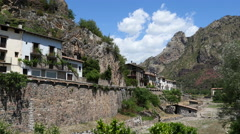 Spain Pyrenees Gerri de la Sal wall and houses with cloud Stock Footage