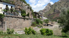 Spain Pyrenees Gerri de la Sal wall and houses Stock Footage