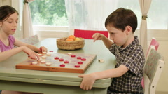 Kids playing checkers game Stock Footage