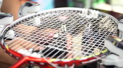 4K Stock footage of Man made weaving badminton racket, by auto machine Stock Footage