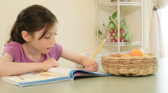 Girl having difficulties preparing her homework - stock footage