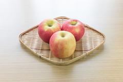 Red apple in basket - stock photo