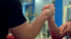 Intense struggle at armwrestling competition two hands close-up - stock footage