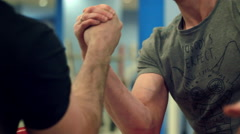 Armwrestling fight between two athletes Stock Footage
