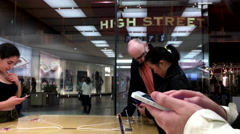 Women buying new iphone inside Apple store with 4k resolution. Stock Footage