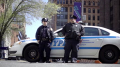 police officers - partners hanging out on NYPD squad car next to NYU - stock footage