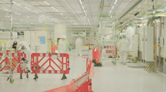 Time Lapse of construction work in a clean room Stock Footage