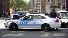 Officer leaning on NYPD cop car - police on Greene Street in Greenwich Village Stock Footage