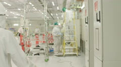 Two construction engineers in a clean room Stock Footage