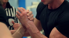 Armwrestling competition fight between two athletes close-up Stock Footage