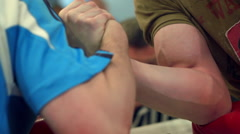 Armwrestling competition fight between two athletes  strong-willed victory Stock Footage