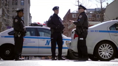 Three officers talking - police cars in 4K video in NYC Stock Footage
