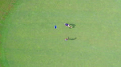 Aerial view father and son on putting green on golf course Stock Footage