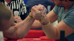 Armwrestling competition fight between two athletes Stock Footage