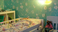 Little boy sleeping and turning off bedside lamp Stock Footage