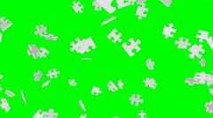 White puzzle pieces falling down - seamless loop, overlay, green screen - stock footage