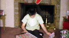 1963: Boy unboxes Fun Chemistry science set for Christmas gift. Stock Footage