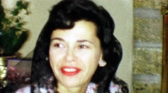 1963: Black haired woman wearing lacy veil matching her hair color. Stock Footage