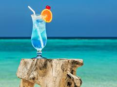 Bocal of cocktail is on sandy coral  beach, Maldives, The Indian Ocean - stock photo