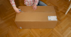 Woman unboxing box Stock Footage