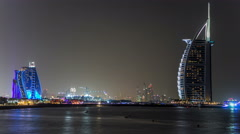 Dubai skyline with Burj Al Arab hotel at night timelapse Stock Footage