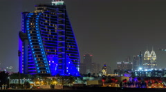 Hotel near Jumeirah beach night timelapse in Dubai, UAE Stock Footage