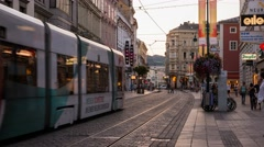 Time lapse Linz Landstrasse Austria with trams and people Stock Footage