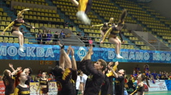 Acrobatic performance of the cheerleading team with crazy jumps. Slow motion. Stock Footage