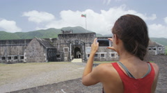 Tourist visiting St. Kitts Brimstone Hill Fortress - Caribbean attraction - stock footage